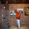 Doug and Tedrowe show off their art hanging skills.