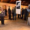 Guests mingling with the artwork.