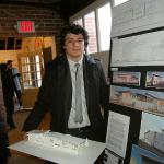 Student Andres Rincon displays his designs and model for the Art House.